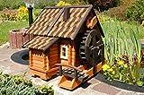 Wunderschöne große Wassermühle aus Holz im blockhausstil mit Holzschindeldach
